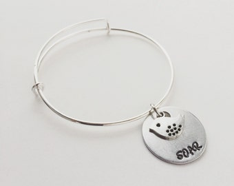 SOAR hand stamped metal & silver bird charm bangle