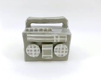 little ceramic boombox, ghettoblaster, miniature, ceramic art, hiphop-style, ceramic sculpture, 80s-style