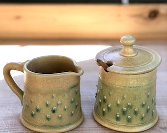 Sugar and Cream Set Matte Peachy Yellow Glaze With Copper Green Wash over a Raised Dot Pattern