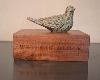 "WRITER'S BLOCK engraved on one edge of 8.5"" x 6.5"" x 3"" black walnut board"