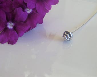 Nail pin head to mount your 54 X 7 mm beads