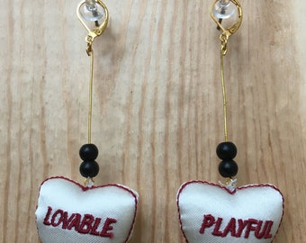 Doll parts earrings - black beads