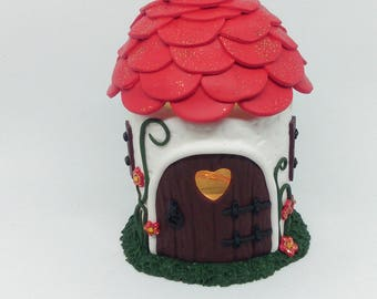 Red fairy house with internal light