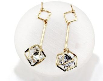 Golden prismatic pendant earrings