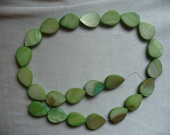 Beads, mother-of-pearl 18x14mm lime green teardrop. Sold per 16 inch strand.   There are 23 beads on the strand.
