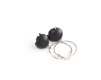 Black flower leather earrings