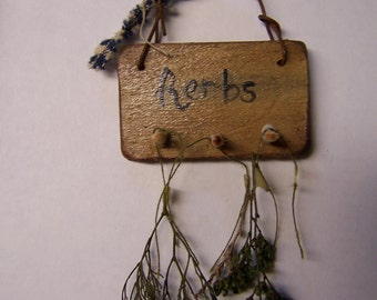 Ann's miniature herb rack with herbs