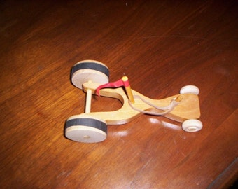 Wooden rubber band powered  Dragster