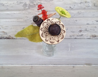 Lime green, brown, and orange button flower bottle bouquet