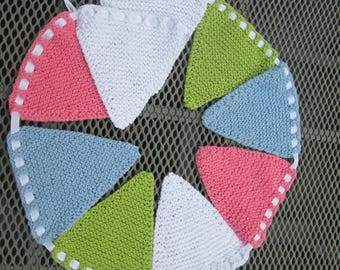 Hand knitted bunting in pink, blue, green and white