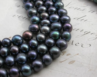 lot 15 pearls natural black peacock in very good quality