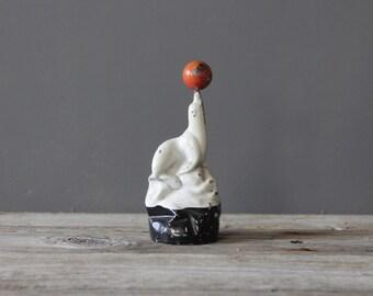 Carstairs Whiskey White Seal Enameld Balancing Ball Figure