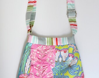 ADJUSTABLE, Ruffled Girl on the Go Bag, in Soul Blossoms print by Amy Butler