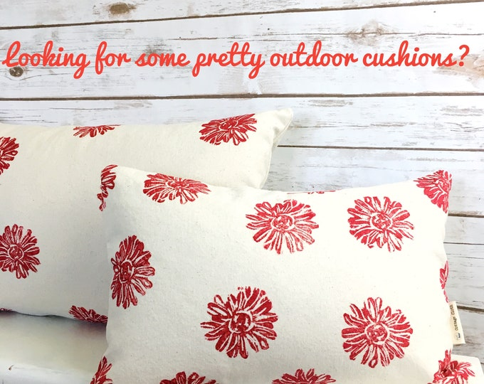 Indoor/outdoor cushions!  Organic cotton handprinted with red heliopsis flowers 🌺