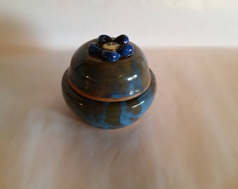 Blue pottery jar with daisy lid