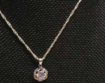 Sterling Silver Flower with center crystal, and rhinestones on sides