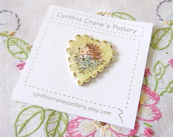 Porcelain Clay Hedgehog Button, Large Scalloped Edge Heart, Lime Green and Brown with Blue Flowers