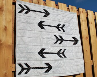 Minimalist arrow quilted nursery blanket. Scandinavian modern play mat. Simple, gender neutral, monochrome baby shower gift. Black, white