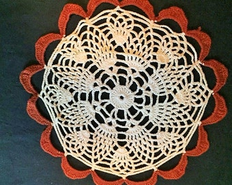 Doily - Vintage crocheted ecru and rust colored