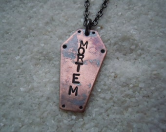 """Coffin Pendant stamped with """"Mortem"""""""