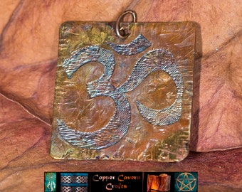 Etched Ohm copper pendant with heat patina