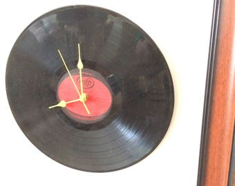 """Hand made clock using a 12"""" record titled Love with Love"""