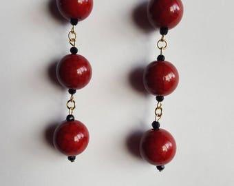 Deep red and black dangle drop beaded earrings.