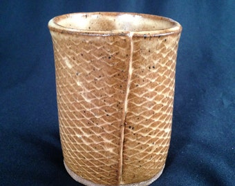 Small brown scales cup