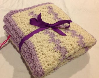 Baby blanket afghan in creamy off white and pale plum with ruffle edge