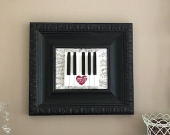 piano keys framed art reusing antique piano keys and vintage sheet music