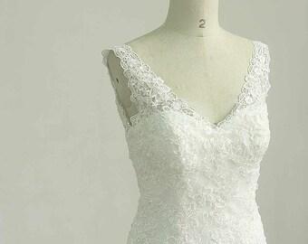 Open back Deep v neckline fit and flare Ivory lace wedding dress