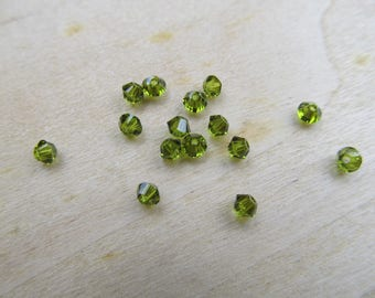 Set of 10 beads form 3 x 3 mm olivine green color Austrian Crystal bicone.