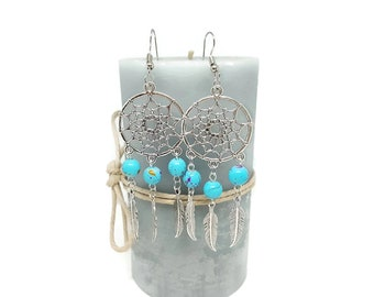 These earrings catch dreams and blue beads
