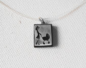 reticulated neck ebony and silver plated Lady and stroller