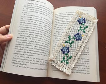 Blue flowers handmade cross stitch bookmark with lace edges