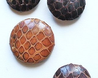 Reptile buttons, 4 different, vintage. 4 examples of reptile skin or hide. 3 pad backs, 1 metal back. c1930's to 40's.