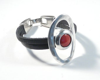 Wristband bracelet featuring  large hammered ring and red enamel