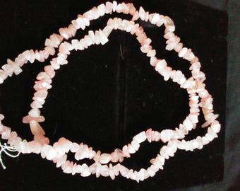 Long, single strand, rose crystal