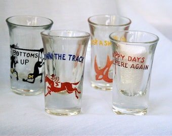 4 Vintage Shot Glasses/ Happy days Are Here Again,Bottoms Up,Down The Track &Just A Swallow