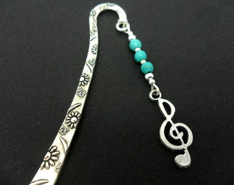 A tibetan silver and turquoise bead treble clef musical note   charm  bookmark.