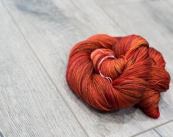 Canadian Hand-dyed sock yarn. 70/20/10 SW Merino/Cashmere/Nylon. 115g 400 yards. Ready To Ship. Firestone, multi-colored red yarn