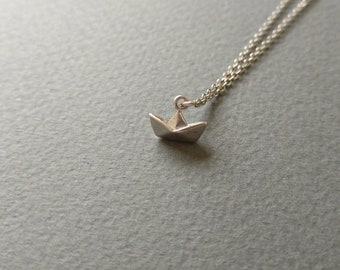 Origami paper boat. Dainty silver charm on a dainty stainless steel chain.