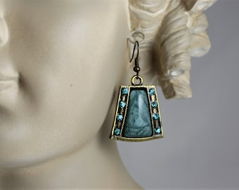 "EGYPTIAN or VICTORIAN  STYLE Earrings, 1 3/4 L, 1""W. Bronze Frame, Green/Blue Center Stone and Sparkly Crystals Down the Sides. Lightweight."