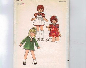 1970s Vintage Sewing Pattern Butterick 6495 Girls Puff Sleeve Dress and Button On Pinafore Apron Size 2 Breast 21 70s UNCUT  99