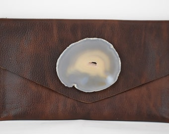 handmade brown cow leather clutch handbag with a milky geode crystal