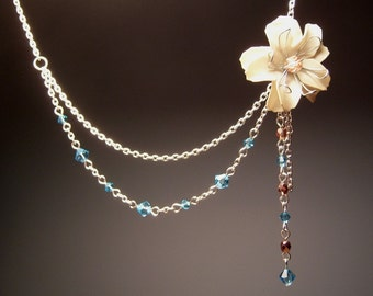 White Flower in Chains Asymmetric Necklace with Aquamarine Swarovski Crystals and Gold Czech Glass Beads