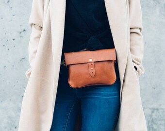 classic button stud hip bag + satchel in cognac // leather fanny pack // solid brass hardware // worn as hip bag, shoulder and cross-body