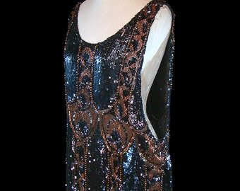 Authentic 1920s flapper dress, Art Deco era couture, solidly beaded & sequined gown, sleeveless black and golden brown, antique red carpet