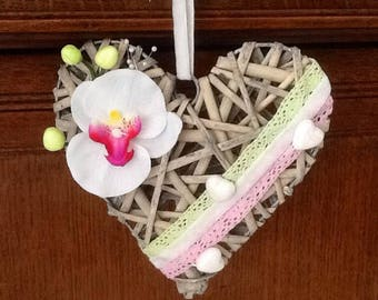 Heart basket decorated with an orchid and lace.