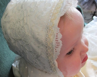 Lace covered satin baby bonnet